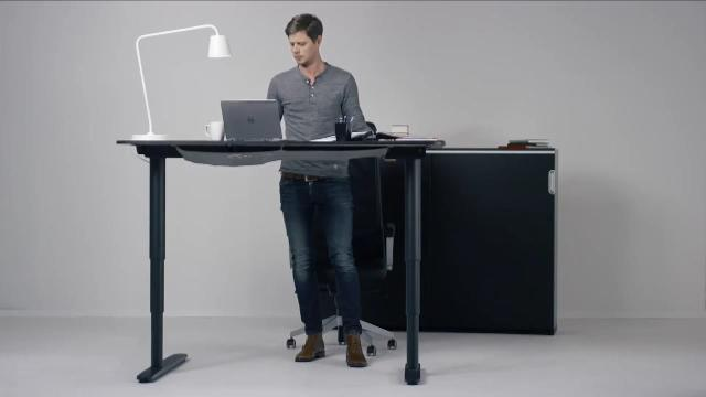 IKEA desk converts from standing to sitting with one button