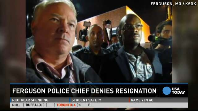 Standing in the parking lot of a gas station which was burned during rioting, Ferguson Police Chief Thomas Jackson on Aug. 15, 2014, announces the name of the Ferguson, Mo., police officer responsible for the Aug. 9, shooting death of teenager Michael Brown.