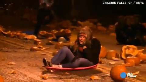 Students create giant slide with smashed pumpkins