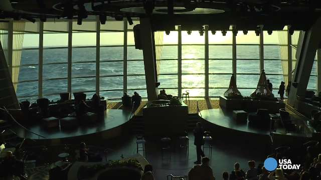 By day, Quantum of the Seas' Two70 is a great place to take in the view and relax. But at night, the space transforms into an entertainment venue featuring a massive projection screen and six robotic, moving video screens.