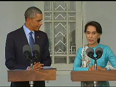 US President Barack Obama embraces Burma's opposition leader Aung San Suu Kyi during a press conference at her residence in Rangoon on Nov. 14, 2014.