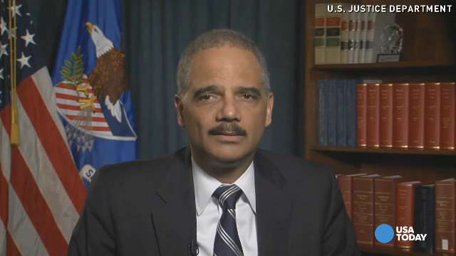 Holder urges police restraint in Ferguson response