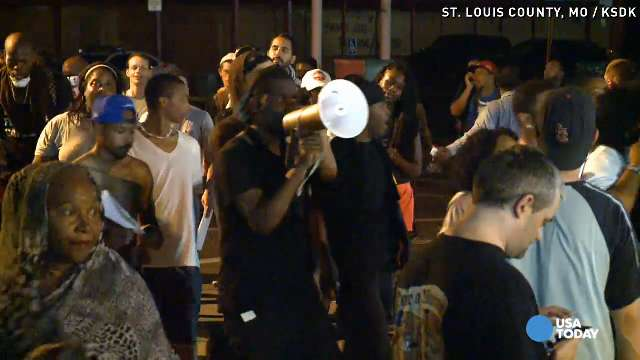 Demonstrators shout slogans during a march in St. Louis