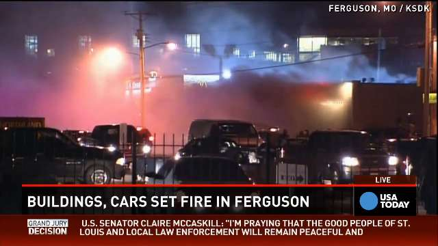Ferguson protesters looting, burning businesses, police cars