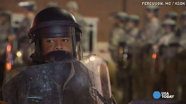 Violence contained in Ferguson, protests sweep nation