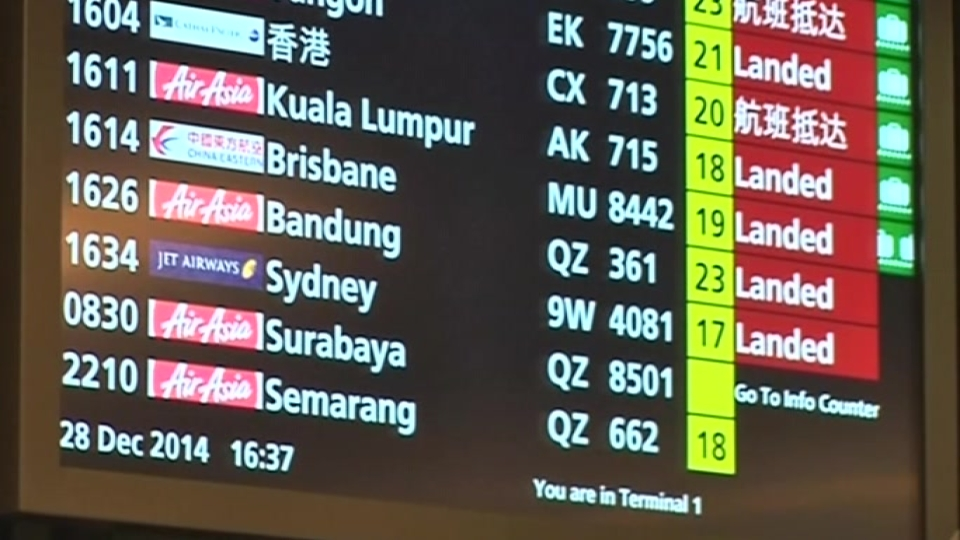 Families await news as search for missing AirAsia plane halts for night