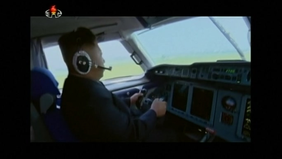 Kim Jong Un steers plane in video