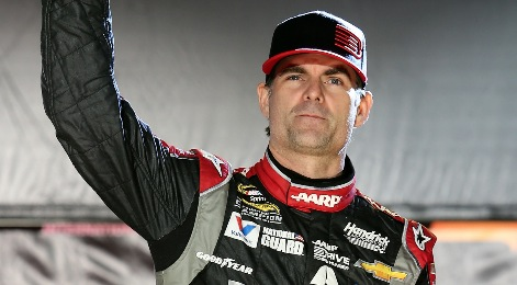 Jeff Gordon crosses the finish line at Indianapolis Motor Speedway, July 27, 2014, to win his fifth Brickyard 400 championship.
