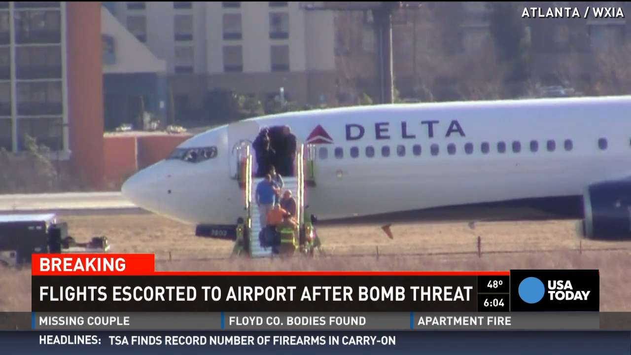 One Delta flight and one Southwest flight were escorted to Atlanta's Hartsfield-Jackson International Airport following bomb threats on Saturday.