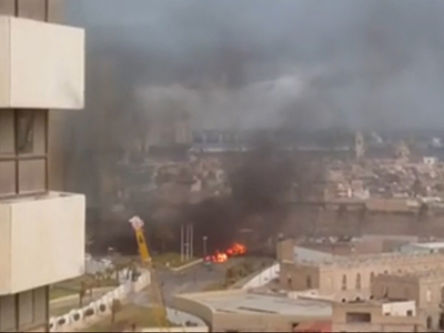 In this image made from video posted by a Libyan blogger, the Corinthia Hotel is seen under attack in Tripoli, Libya,  Tuesday, Jan. 27, 2015.