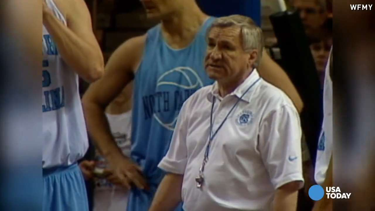 North Carolina Tar Heel former head coach Dean Smith and former player Michael Jordan talk during the Professional Alumni game at the Dean E. Smith Center in 2009. Mandatory Credit: Bob Donnan-USA TODAY Sports