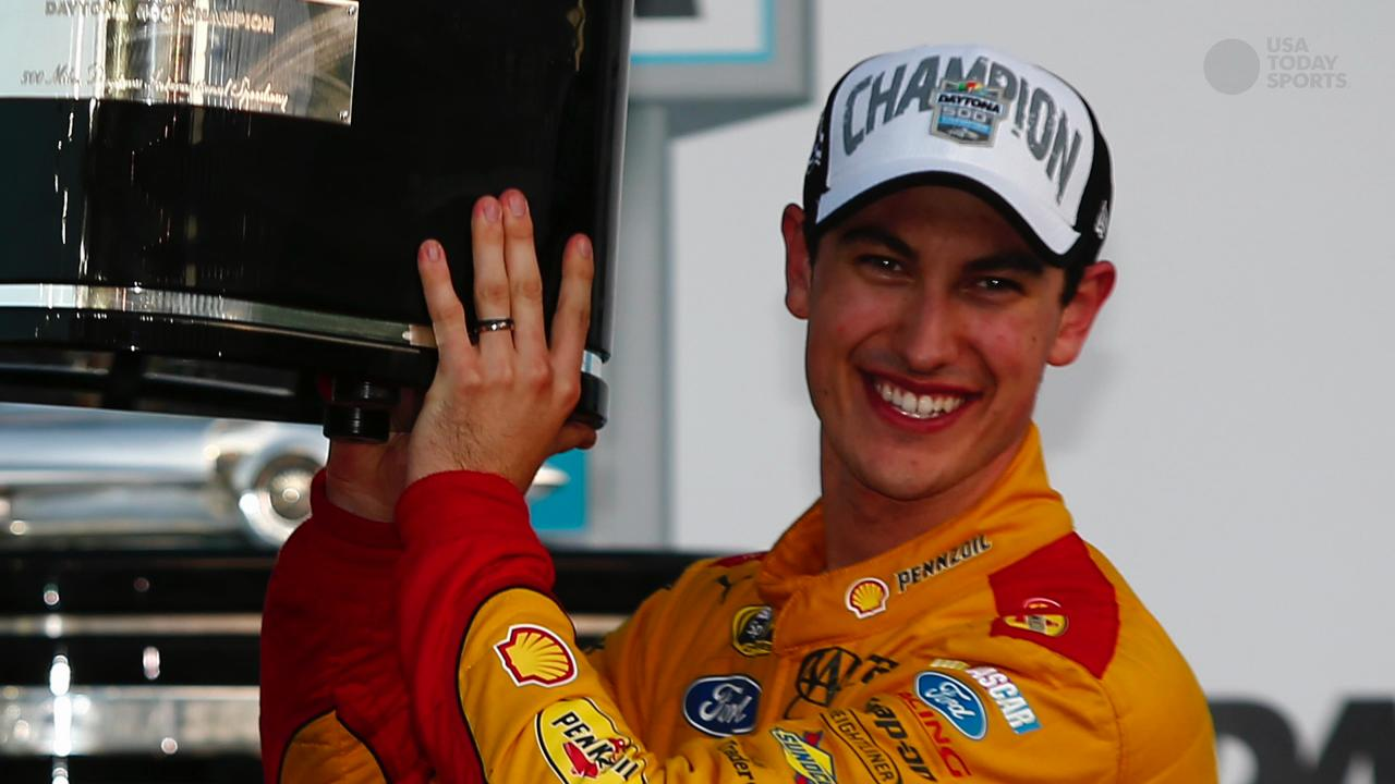 Joey Logano celebrates in victory lane after winning the NASCAR Sprint Cup Series 57th Annual Daytona 500 at Daytona International Speedway on Sunday.