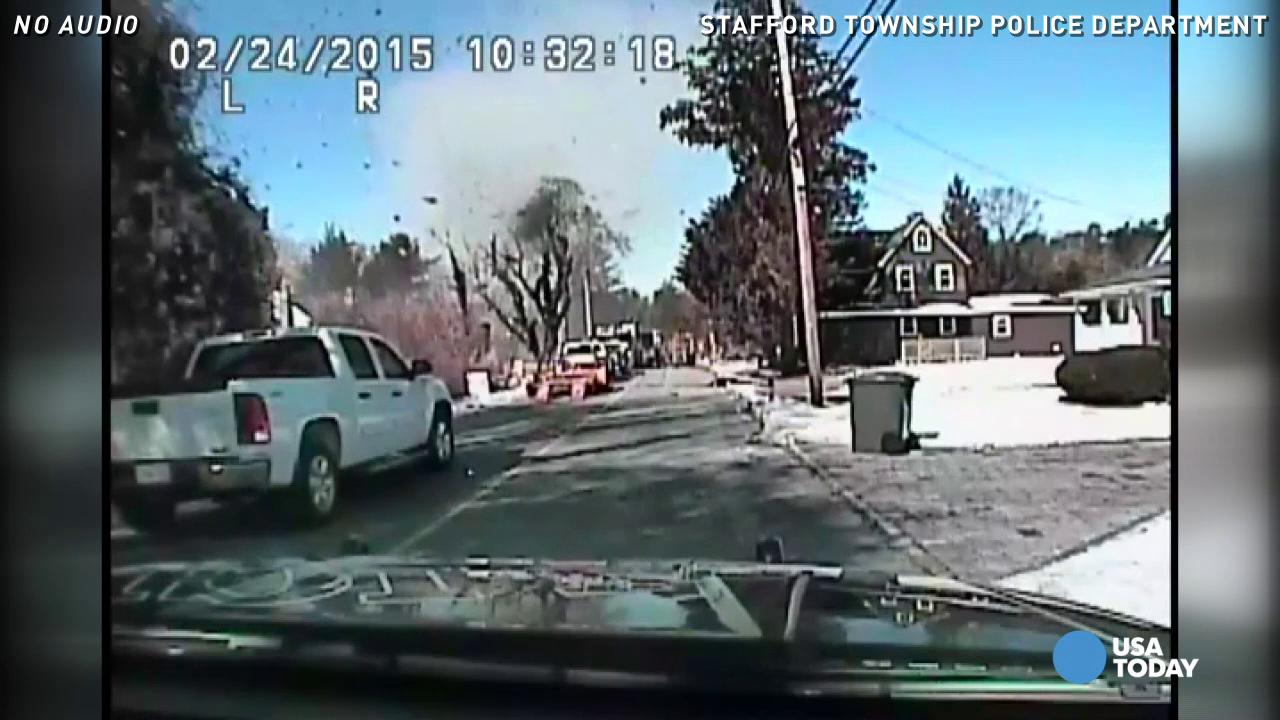 Huge house explosion caught on police dash-cam