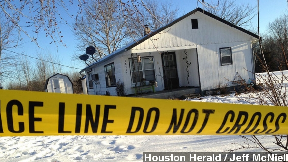 Police tape surrounds one of the crime scenes in Tyrone,