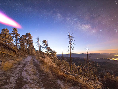 Raw: Pink cloud visible after rocket launch