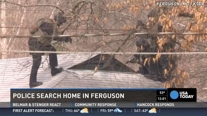 Police search Ferguson home after officer shooting