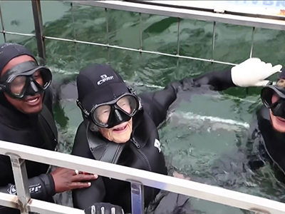 Woman shark dives and skydives to celebrate 100th birthday