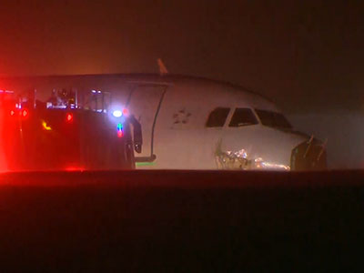 Raw: Passengers hurt as plane skids off runway