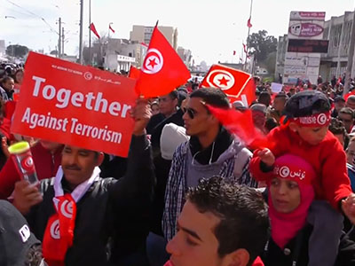 Raw: Thousands march in Tunis against extremism