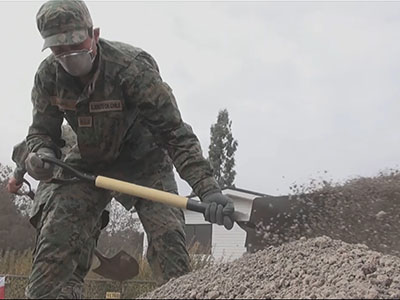 Soldiers shovel mounds of ash from Chile volcano