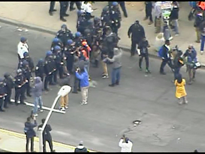 Raw: Protestors and police in Baltimore