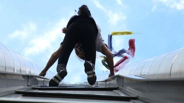French 'spiderman' climbs Paris tower for Nepal victims