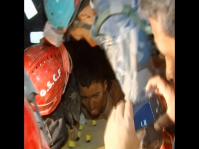 Raw: Nepal man alive after 82 hours in rubble