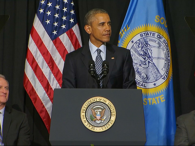 Obama visits 50th state, touts community college