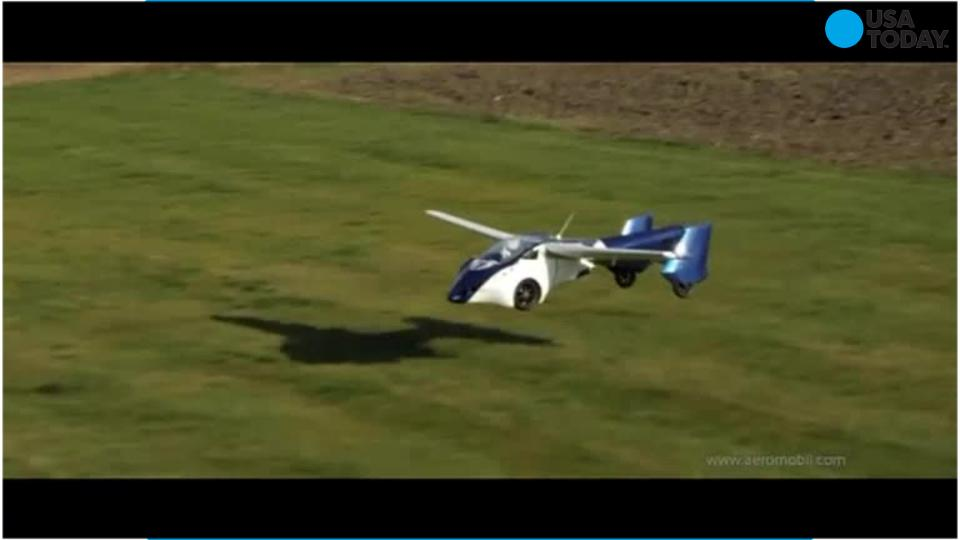 Flying car falls from sky, parachutes to safety