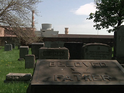 Cemetery surrounded by auto plant opens, briefly
