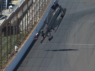 Raw: Indy car flips, goes airborne