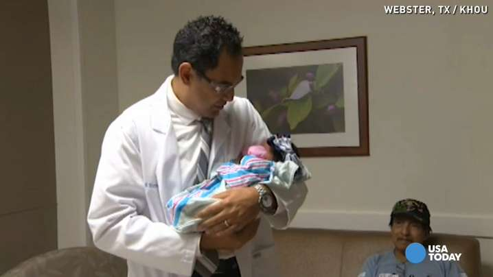 Doctor walks in waist-high flood waters to deliver babies