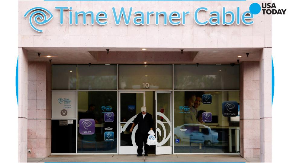 File photo taken in 2015 shows a Charter Communications retail and customer service location in St. Louis, Mo.