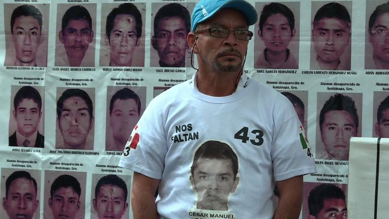 Four family members of the 43 students who went missing in Mexico last year protest outside the Mexican embassy in Buenos Aires to mark the eight-month anniversary of their relatives' disappearance. 
