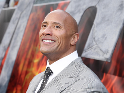 Dwayne Johnson hops on a fire truck
