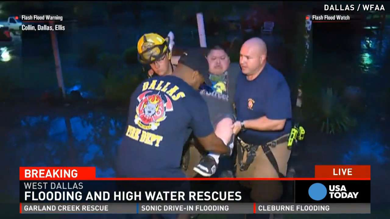 Rescuers carry man with Down syndrome from flooded home