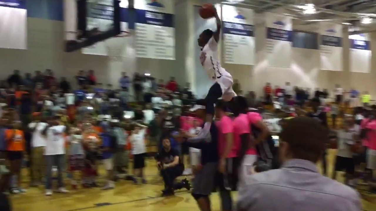 Watch this guy jump over 4 people for a monster dunk