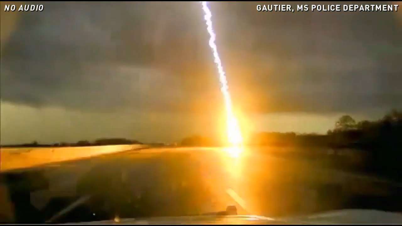Cop's dashcam captures crazy close lightning strike