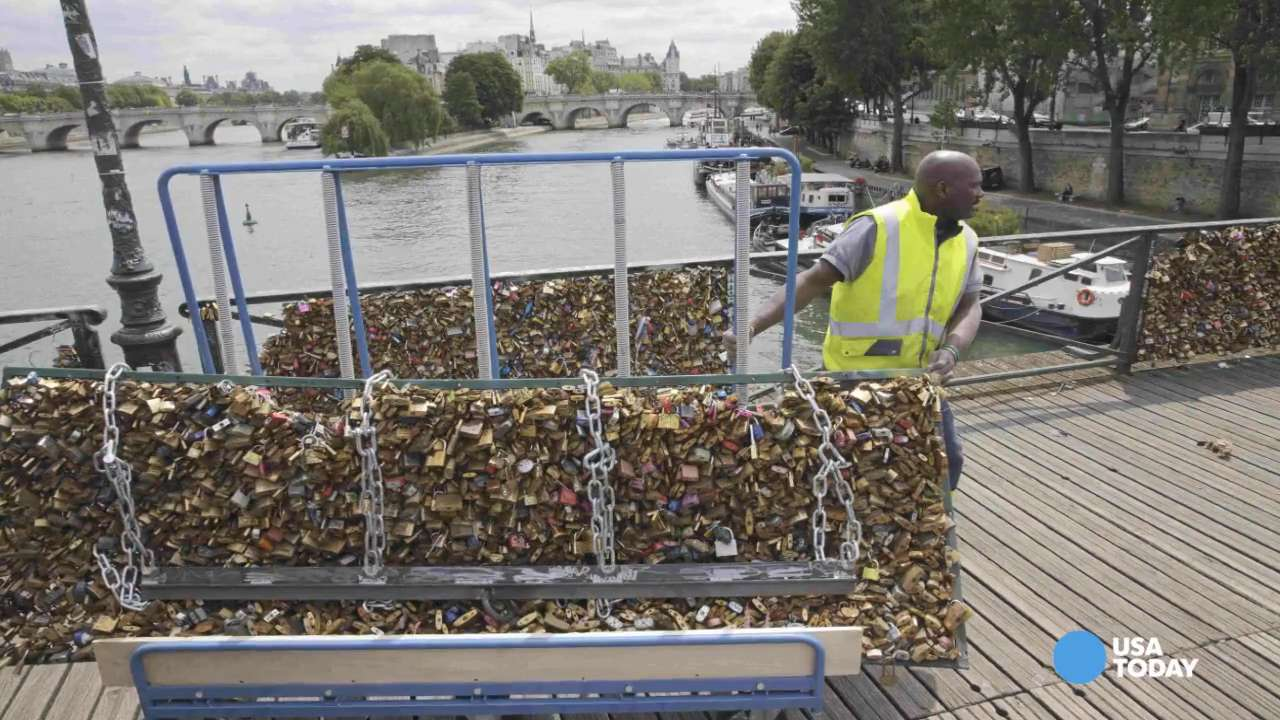 Iconic 'love locks' being removed from Paris bridge