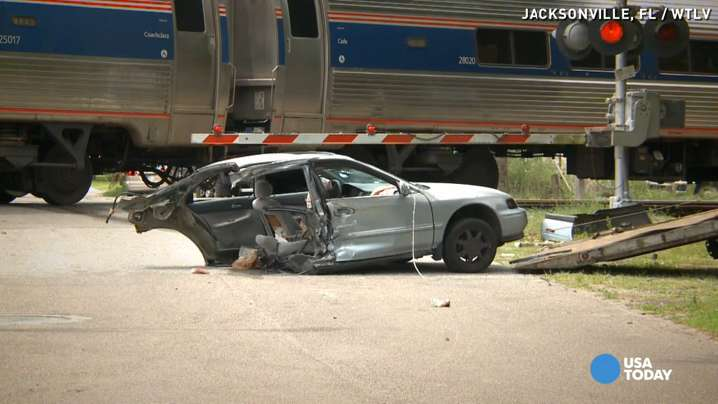 Video shows Amtrak train slice car in half