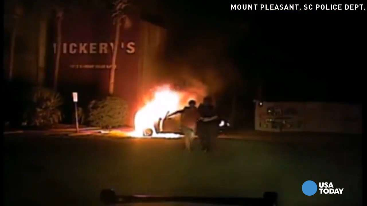 Watch cop pull man out of burning car