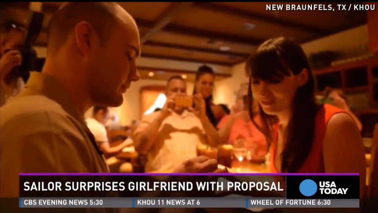 Sailor surprises girlfriend with proposal