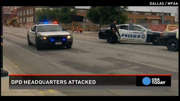 Dallas police headquarters attacked, gunman surrounded