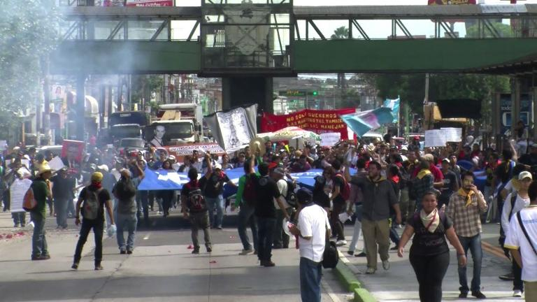 Thousands of protesters take to the streets of Guatemala City to demand the resignation of President Otto Perez, who is accused of being involved in a corruption scandal. Video provided by AFP