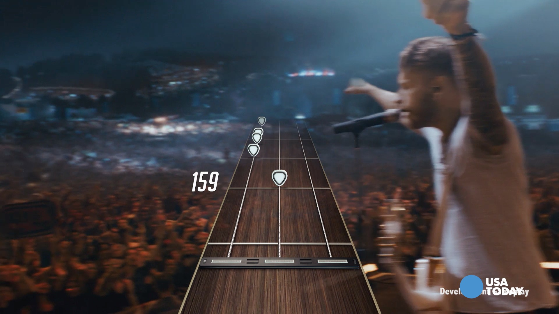 "The next version of ""Guitar Hero"" features a new controller and live action concert footage rather than digital characters. Mike Snider checks out the new game at the 2015 E3 convention."