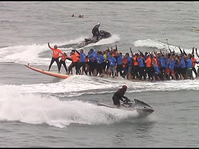 New record set for most riders on a surfboard
