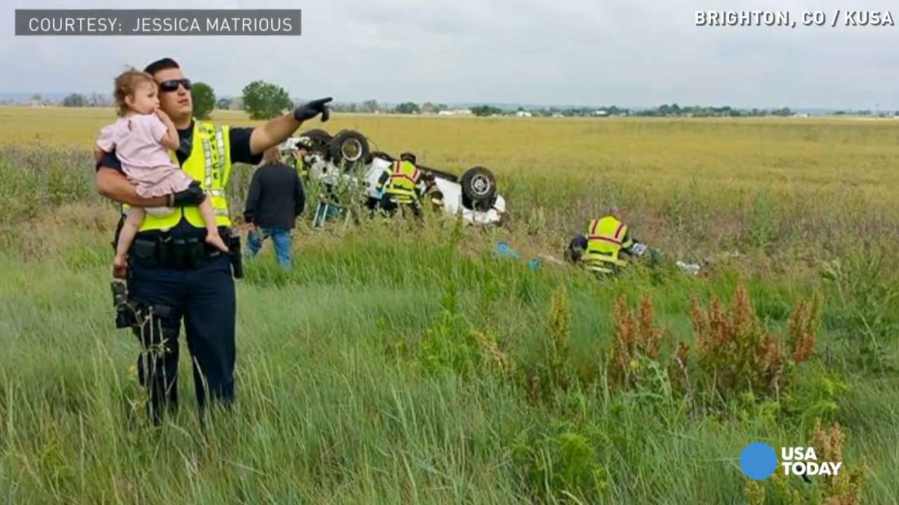 Cop comforts 2-year-old after dad's deadly accident