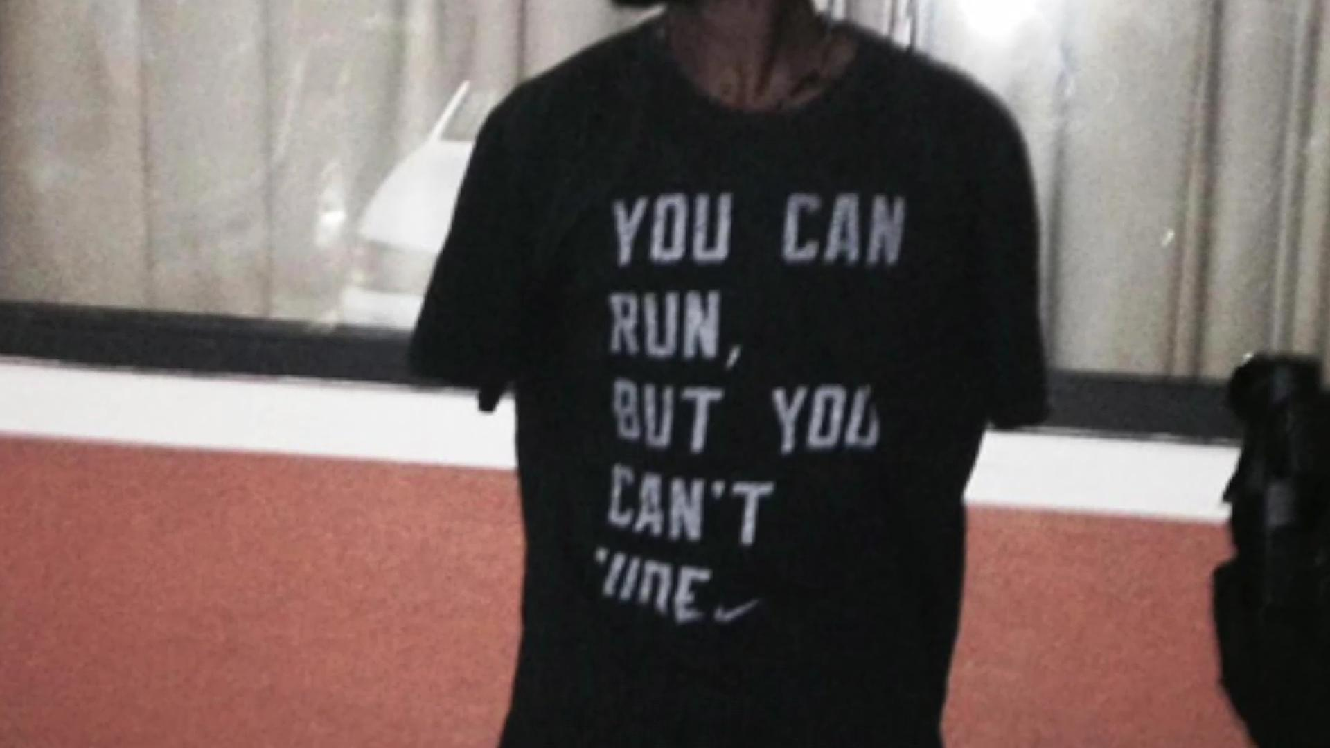 """Fugitive arrested wearing """"You can run, but you can't hide"""" shirt"""