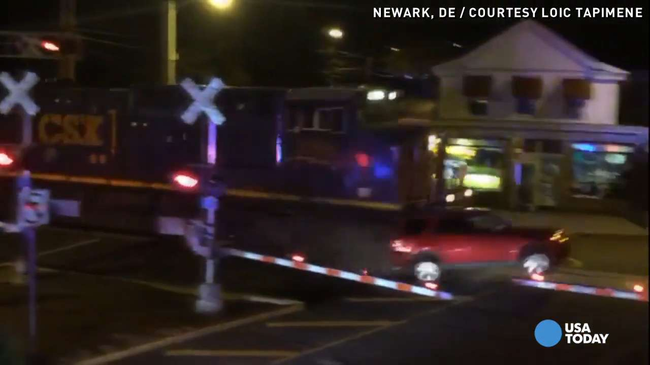 Watch: Train slams into SUV after officers rescue driver