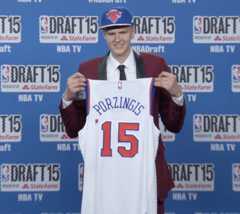 Kristaps Porzingis (SPN) reacts after being selected